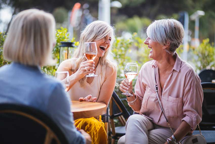 Ladies enjoying wine outdoors