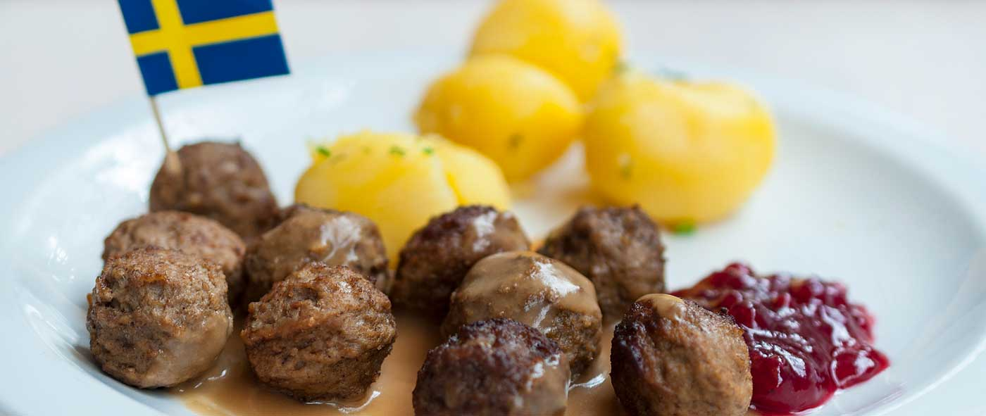 Swedish meatballs on a white plate.